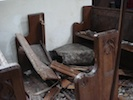 Broken pews in Pillaton church
